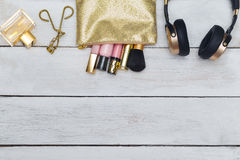 Cosmetic, lip gloss in  Cosmetic bag golden color. flat lay. Cosmetic, lip gloss in Cosmetic bag golden color Royalty Free Stock Images