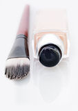 Cosmetic liquid foundation and brush on white Stock Photo