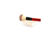 Cosmetic loose powder in jar with brush. On white background Royalty Free Stock Photos