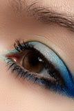 Cosmetic. Macro of sky-blue eye make-up, eyelashes Stock Photography