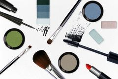 Cosmetic with make up tools on white leather Stock Image
