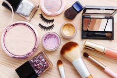 Cosmetic with makeup products and brushes Royalty Free Stock Photo