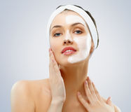Cosmetic mask. Beauty woman getting facial mask Stock Photos