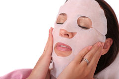 Cosmetic mask. Young woman with a cosmetic mask Stock Photography