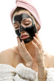Cosmetic mask. A beauty young girl making a cosmetic mask stock photo