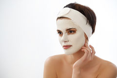 Cosmetic Mask. Beautiful Young Woman Getting a Beauty Treatment. In Spa Salon Royalty Free Stock Images
