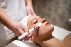 Cosmetic and massage treatment at wellbeing saloon Royalty Free Stock Photo