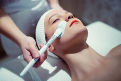 Cosmetic and massage treatment at wellbeing saloon Stock Images