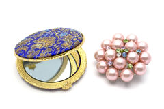 Cosmetic mirror and brooch Royalty Free Stock Photography