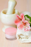 Cosmetic moisturizing cream towels and  flower Stock Photography