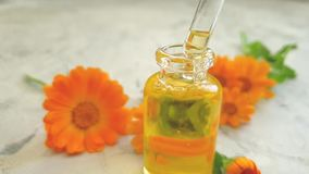 Cosmetic oil flower dripping essence organic calendula slow motion healthy. Cosmetic oil flower calendula, dripping slow motion healthy organic essence stock video footage