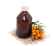 Cosmetic oil of sea buckthorn Royalty Free Stock Photos