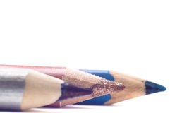 Cosmetic pencils closeup isolated on white background Stock Photography