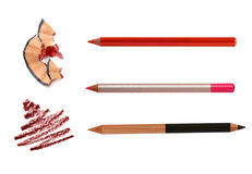 Cosmetic pencils sharpening with husk on white and Stock Image