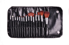 Cosmetic pouch filled with a makeup kit Stock Photography