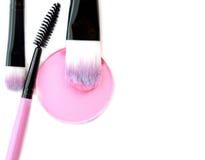 Cosmetic powder brush circle box and crushed blush palette isolated on white. Royalty Free Stock Image