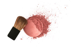 Cosmetic powder brush and crushed blush palette Royalty Free Stock Photo