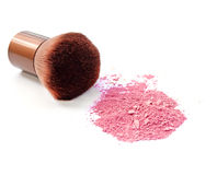 Cosmetic powder brush and crushed blush palette isolated on white Royalty Free Stock Images