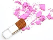 Cosmetic powder brush and crushed powder on white Royalty Free Stock Photo