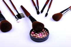 Cosmetic powder and brushes Stock Photography