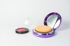 Cosmetic and powder puff isolated Stock Images