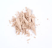 Cosmetic product. Crumbled blush on a white background Royalty Free Stock Photography