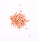 Cosmetic product. Crumbled blush/foundation on a white background Stock Image
