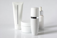 Cosmetic products. Set of cosmetic products in white containers on light background Stock Images