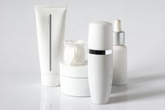 Cosmetic products. Set of cosmetic products in white containers on light background Stock Photography