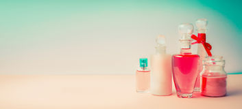 Cosmetic products banner. Different cosmetic bottles collection on Beautiful pink turquoise blue background, front view. Cosmetic shop, Beauty, skin and hair Royalty Free Stock Image
