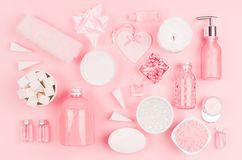 Cosmetic products for bathroom, health and hygiene in modern girlish style - decorative heart, soap, bath salt, essential oil. stock photos