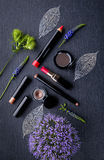 Cosmetic products for make-up with flowers Royalty Free Stock Photography