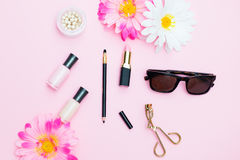 Cosmetic products: nail polish, powder and other accessories on Stock Photography
