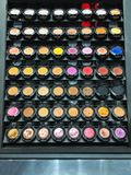 Cosmetic products the portions of colorful eyeshadow for makeup experiment as background.  stock image