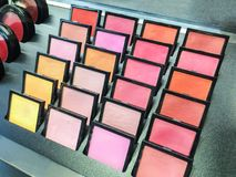 Cosmetic products the portions of colorful eyeshadow for makeup. Experiment as background royalty free stock photo
