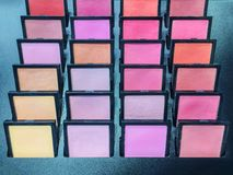 Cosmetic products the portions of colorful eyeshadow for makeup experiment. royalty free stock photos