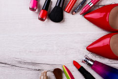 Cosmetic products and shoes. Stock Photos