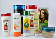 Cosmetic products for skin and hair care from global brands Garnier, L'Oreal, Biotique Stock Images