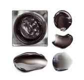 Cosmetic products smear paint of black facial mask Stock Image