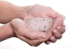 Cosmetic salt in hands Royalty Free Stock Photography