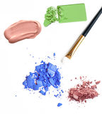 Cosmetic samples,  blue eyeshadow, foundation on white Royalty Free Stock Images