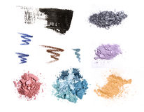 Cosmetic samples isolated on white. Eyeshadows, mascara and pencil strokes Stock Photos