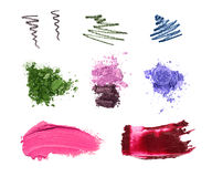 Cosmetic samples isolated on white. Lipstick, eyeshadows, pencil strokes Royalty Free Stock Photos