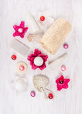 Cosmetic set for bath with perfume flowers, salt and oil balls, sponge, pumice Stock Photography
