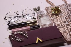 Cosmetic set: glass, perfume, handbag, mascara and lip gloss royalty free stock images