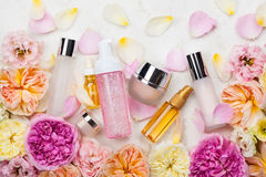 Cosmetic set and flowers Royalty Free Stock Image