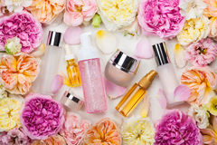 Cosmetic set and flowers Stock Image