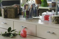 Cosmetic set of an ordinary woman on a light dressing table royalty free stock images