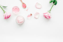Cosmetic set with rose blossom and body cream on white desk background top view mock-up Stock Photo