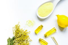 Cosmetic set with seasalt, oils and lemon white background top v. Yellow cosmetic set with seasalt, essential oils and fresh lemon on white background top view Royalty Free Stock Image